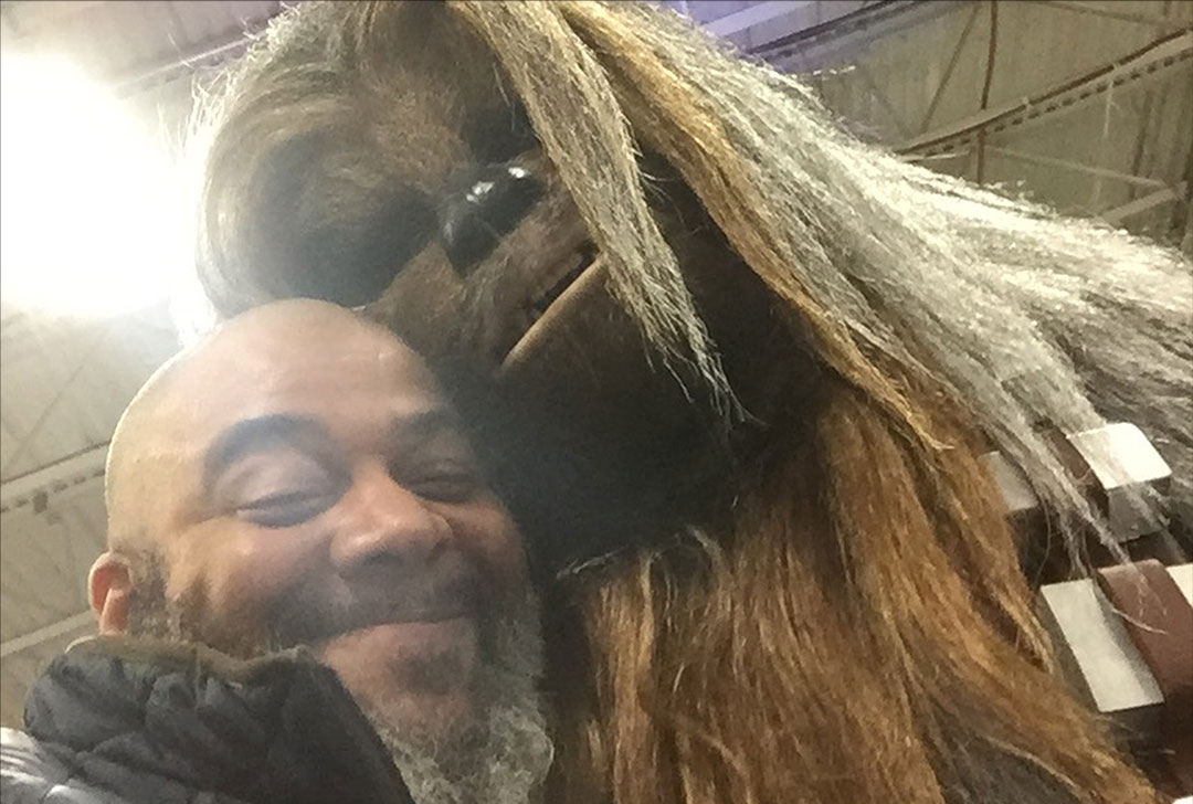 Tim Fielder posing with Chewbacca at a con